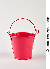 Red bucket on white background.
