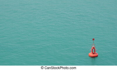 Red buoy floating in sea water - Red buoy floating in the...