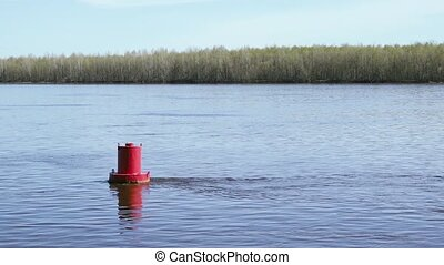 Red buoy on the lake