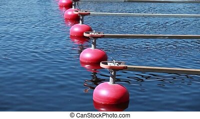 red buoy - red buoys floating on blue ocean. Loop.Tripod....