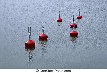 Red buoys in the lake water surface