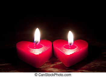 Red burning heart shaped candles - Red burning heart shaped...