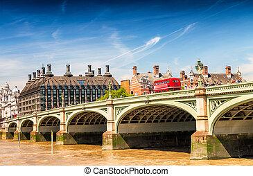 Red bus on Westminster Bridge, London - UK