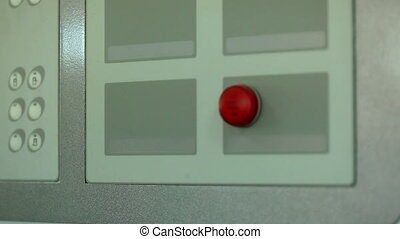 Red button and indicator on control panel - View of red...