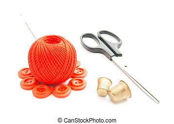 red buttons, thimble, thread and scissors