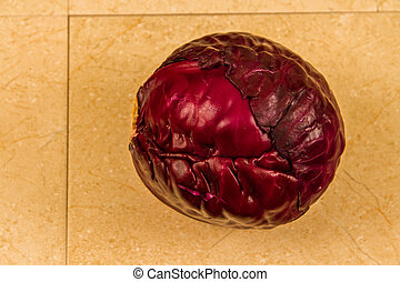 Red cabbage on tiles. - Red cabbage on beige tiles.