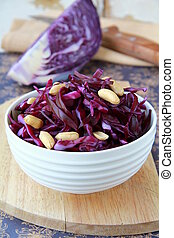Red cabbage salad with nuts in a white cup