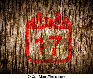 Red Calendar with Date Icon on Wood.