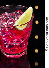 Red Campari Cocktail in short glass with lemon decoration