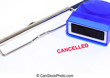 Red cancelled stamp on white paper with rubber stamper and clipboard.