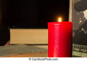 Red candle and some old books