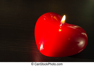 Red candle in the form of heart