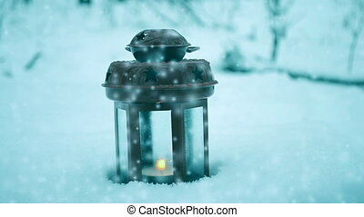 Red candle lantern in the winter forest. Snow forest snowfall. Christmas