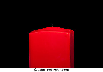 red candle on black background