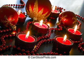 Red candles, beads decorated with reflective surfaces.