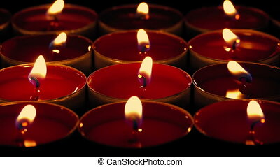 Red Candles Burn At Night