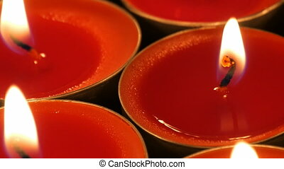 Red candles, camera pans slowly to the right