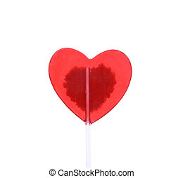 Red candy heart isolated on white.