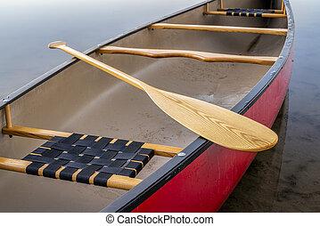 red canoe on a calm lake