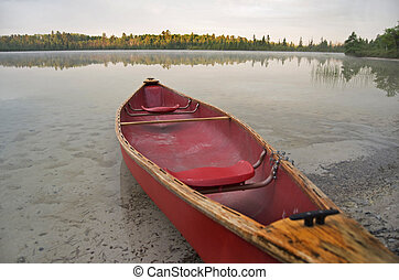 Red Canoe On Calm Lake