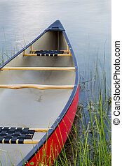 red canoe on lake