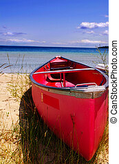 Red canoe on the shore