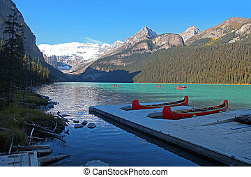 Red Canoes for recreation at Moraine lake in Alberta, Canada