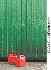 Red cans and green wall