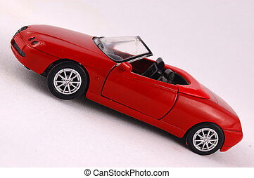 Red car - A red sport cabriolet sport car toy isolated on ...