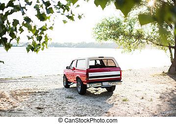 red car at riverside