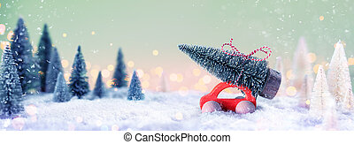Red Car Carrying A Christmas Tree In Defocused Snowy Landscape