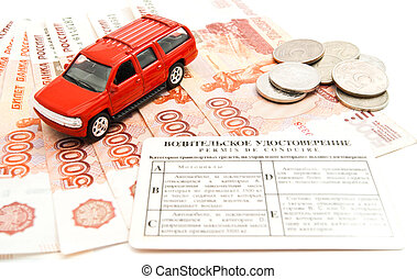 red car, driving license and banknotes