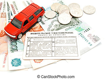 red car, driving license and money