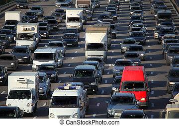urban traffic - red car in big urban traffic