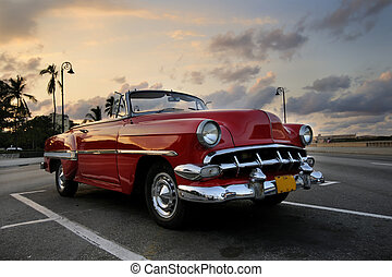 Red car in Havana sunset - View of red classic vintage ...
