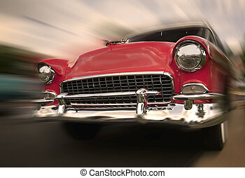 Red Car In Motion - Red muscle car in motion cruising at...