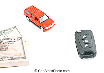 red car, keys and money on white