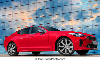 Red car on a blue sky background with white clouds. A stylish, modern, bright image of an avto mobile for design solutions.