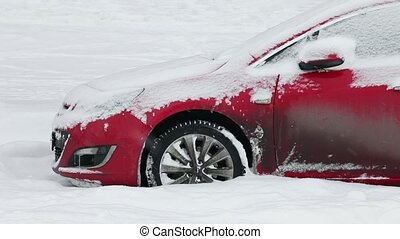 Red car on a snowy road
