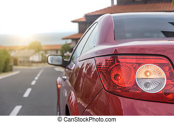 Red car on city streets. - Red car on city streets in a...
