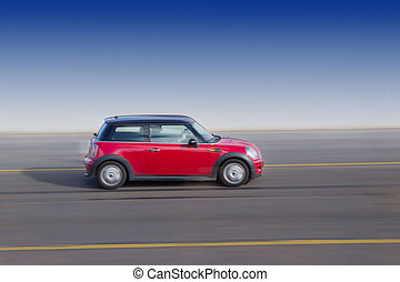 Red Car on highway with motion blur