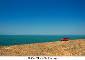 red car on the slope