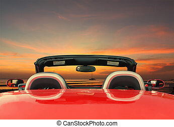 Red car with twilight background