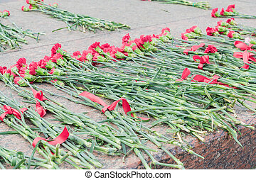 Red carnations at the monument in honor of the victory day of Great Patriotic war in memory of those who