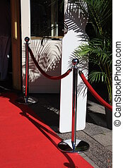 red carpet entrance - red rope and red carpet near entrace