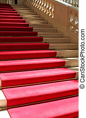 Red carpet on clasically designed marble staircase