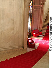 Red carpet stairs - Red carpet with sofas and window