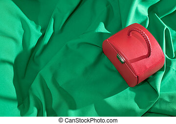 Red case on the green background