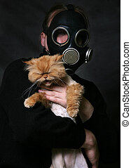Red cat - The man in a gas mask holds a shouting red cat