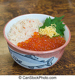 Red caviar and crab sashimi raw fish seafood rice bowl -sashimi on rice, donburi, japanese food